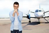 phobia, fear, sorrow and people concept - unhappy man thinking over airplane on runway background poster