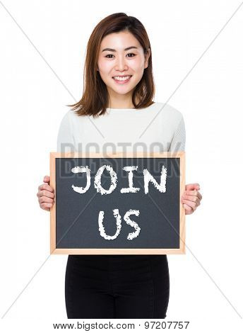 Young woman with the blackboard showing phrase of join us poster
