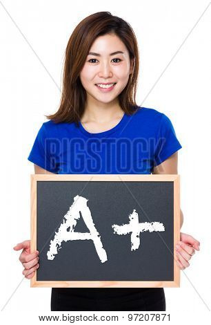 Asian woman hold with chalkboard and showing mark A plus