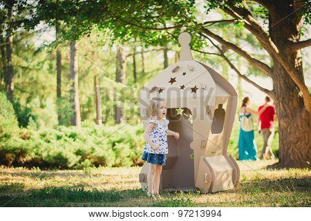 girl playing in cardboard spaceship