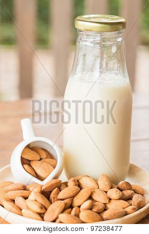 Bottle Of Almond Milk On Wooden Table