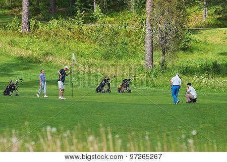 Playing golf.