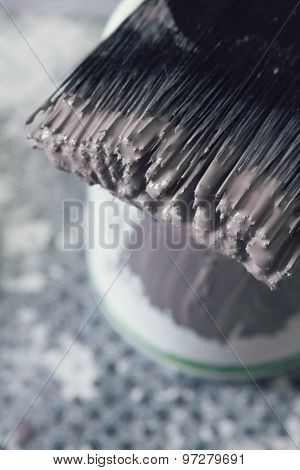 Close Up Of Wet Paint On Brush Bristles Overhead Vertical
