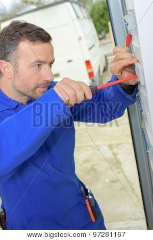 Using a screwdriver on a fusebox