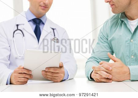 medicine, health care, people and technology concept - close up of f male doctor and patient hands with tablet pc computer