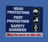 construction site safety with symbols of hard hats and harnesses poster
