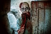 Horrible scary zombie man on the ruins of an old house. Horror. Halloween.  poster