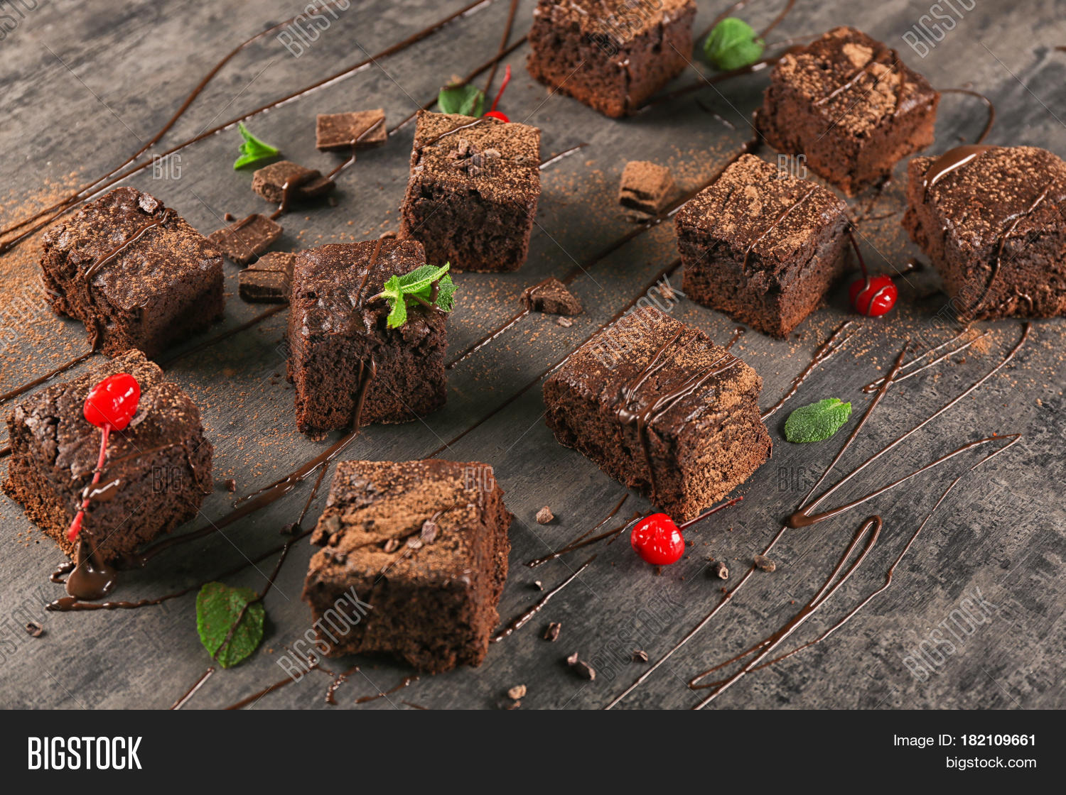Delicious cocoa brownies on table