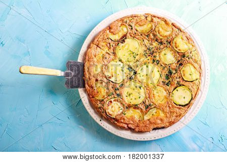 Zucchini and spinach frittata on plate top view