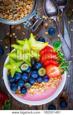 Healthy Breakfast Bowl: Raspberry Smoothies With Granola, Blueberries, Strawberries And Carambola