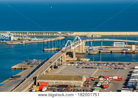 Porta d'Europa Bridge at the entrance to Port of Barcelona overlook, Catalonia, Spain.