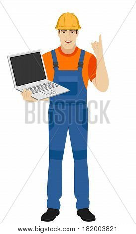 Builder holding laptop notebook and pointing up. Full length portrait of builder in a flat style. Vector illustration.