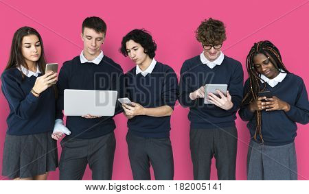 Diverse Group Of Students Using Electronic Devices