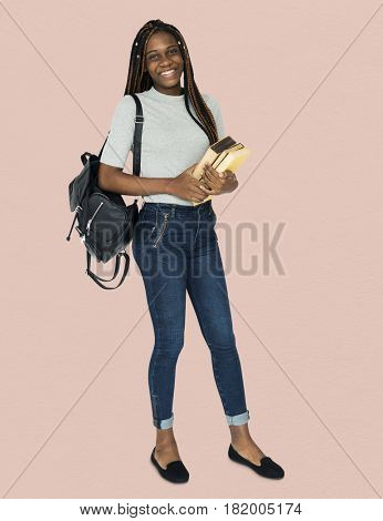 African girl student smiling and holding textbook