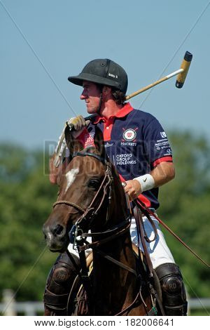 TSELEEVO, MOSCOW REGION, RUSSIA - JULY 26, 2014: Unidentified player of British schools with mallet during the British Polo Day. Bacon become the best player of the match