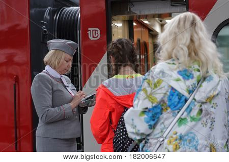 ST. PETERSBURG, RUSSIA - MAY 28, 2016: Passengers at the double-decker train Mikhail Ulyanov in the day of its first departure from St. Petersburg to Adler. The train is operated by Russian Railways