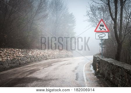 Slippery Road In Rainy Weather, Warning Roadsign