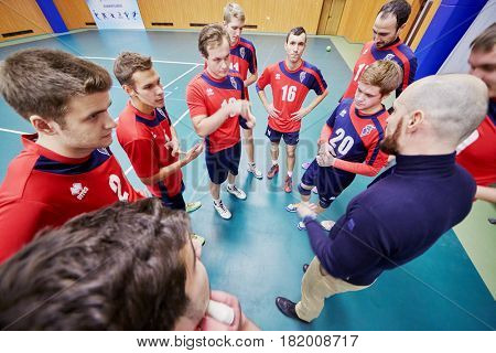 MOSCOW, RUSSIA - OCT 26, 2016: Trainer and volleyball team of MSAPC during match between MSU and Moscow State Academy of Physical Culture at sports playground of Lomonosovsky building of MSU.