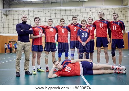 MOSCOW, RUSSIA - OCT 26, 2016: Trainer and volleyball team of MSAPC after match between MSU and Moscow State Academy of Physical Culture at sports playground of Lomonosovsky building of MSU.