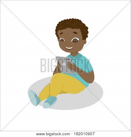 Boy with gadgets on white background. African american boy with tablet. Computer addiction.