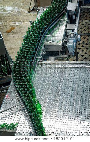 CESKE BUDEJOVICE, CZECH REPUBLIC - JUNE 30, 2016:  Budvar Budweiser brewery. Bottle sorting washing and beer bottling workshop with assembly-lines.