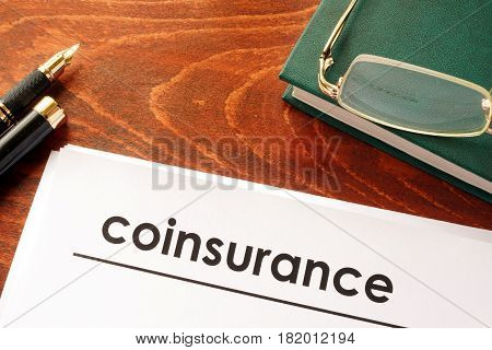 Document with title coinsurance on a table.