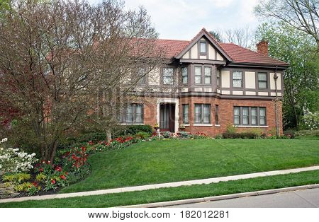 English Tudor Home with Spring Flowers