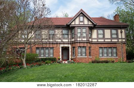 English Tudor Home with Red Spring Tulips