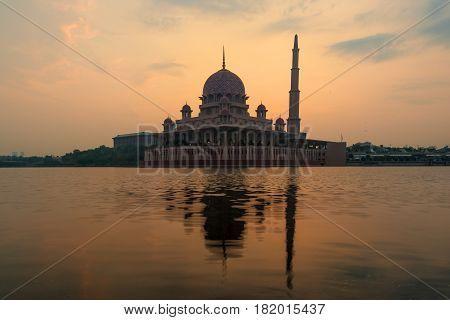 Putrajaya mosque between sunsire in Kuala Lumpur Malaysia. Pink mosque in Kuala Lumpur Malaysia.