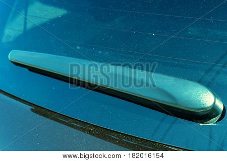 Close-up photo of wind-screen wiper on modern car