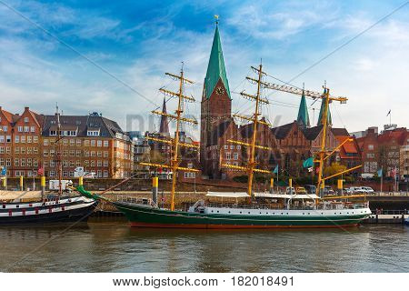 Embankment of the Weser River and Protestant Lutheran Saint Martin Church in the old town of Bremen, Germany.
