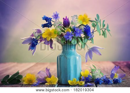Still life with beautiful flowers on wooden table