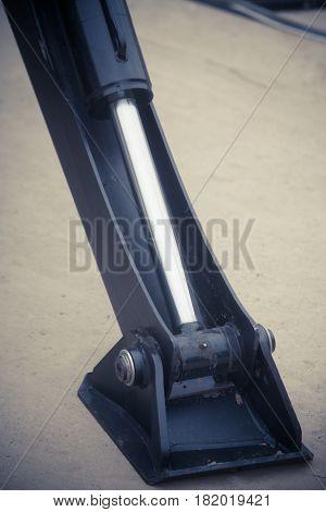 Close up shot of a hydraulic piston on a machine.