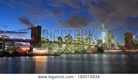 Manhattan skyline with Brooklyn Bridge at night - view with star effect