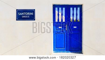 Blue Door On A Whitewashed Wall - Cyclades, Greece.