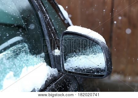 detail shot of a car mirror with snow
