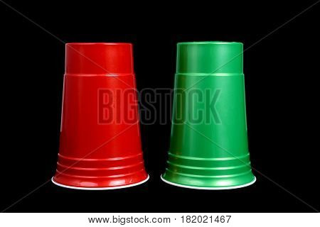 two cups upside down on black background