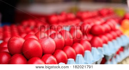 Red Easter Eggs For Sale At An Open-air Market