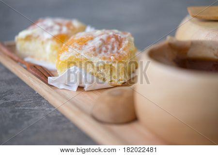 Tasty bread with sugar powder on wood plate