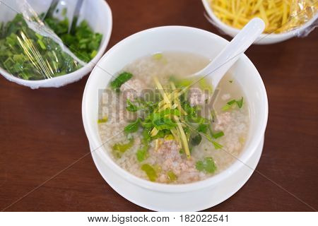 Top view of boiled rice pork or mush - Thai style breakfast