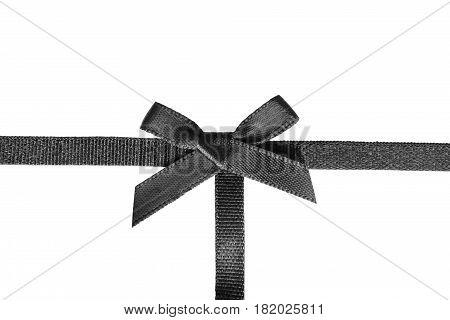 Black satin tied bow ribbon on white background