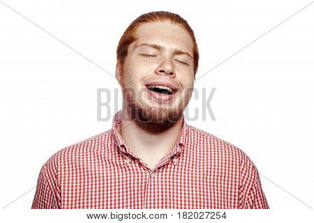happy smiley laughing bearded readhead businessman with red shirt and freckles looking at camera. studio shot isolated on white.