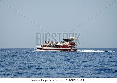 TENERIFE, SPAIN - JULY 1, 2011: The ship with tourists in the ocean off the coast of Tenerife.
