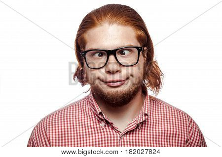 Carzy funny cross eyed bearded readhead businessman with red shirt and freckles and glasses looking at camera. studio shot isolated on white.