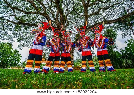 Kid dancers with ghost mask made from bamboo to show in Thai northeastern traditional Phi Ta Khon ghost Festival