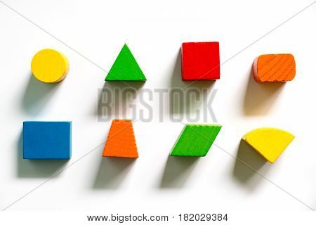 Set of colorful wooden shape toy on white background