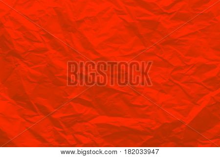 Background of crumpled red paper. Wrinkled paper close-up