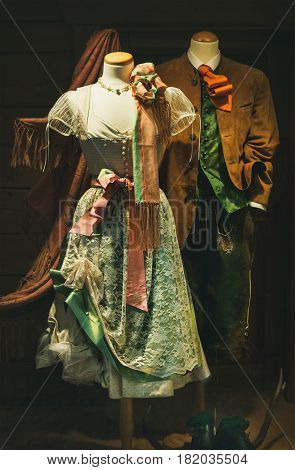 Austrian national folk costumes or garment for men and women. Traditional Tracht. Feminine dress Dirndl and men' s Lederhosen short breeches made of leather, and suit jacket