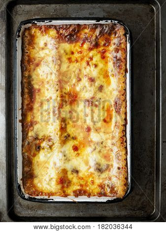 close up of rustic italian lasagna with bolognese ragu sauce