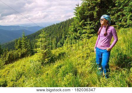 happy woman tourist admiring views of the mountains. Hiker girl enjoying beautiful mountain view. Tourist in the mountains. Healthy lifestyle, adventure, hiking trip